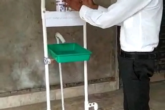 Foot operate machine to provide water and sentizer