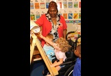 Foster Grandparent provides assistance to a child with special needs